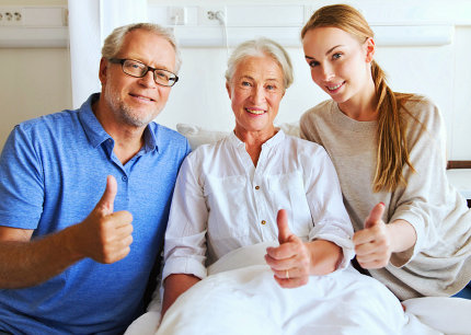 elderly couple and staff smiling